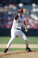 Scott Schoeneweis of the Los Angeles Angels pitches during a 2002 MLB season game at Angel Stadium, in Anaheim, California. (Larry Goren/Four Seam Images)