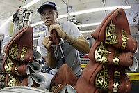 20 January 2005: Charles Moore turns footballs (flips them outside out after they have been sewn together) at the Wilson football factory where Super Bowl footballs are made Thursday January 20, 2005 in Ada, Ohio.<br />