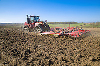 Cultivating winter ploughing ready for drilling spring beans - Suffolk, April