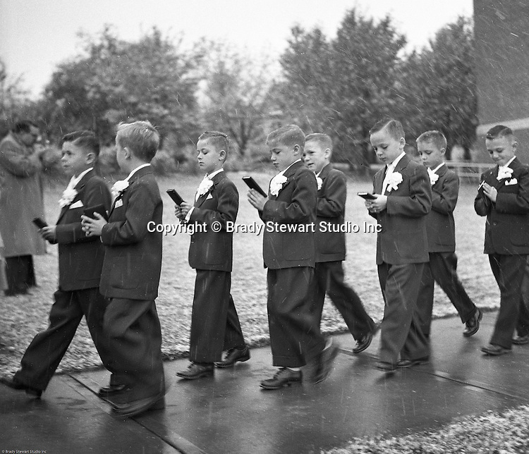 Bethel Park PA:  View of young catholic boys walking to church to receive their first holy communion at Saint Valentine's Church.  Cathy Stewart was part of the class that received their first holy communion in 1954.  St Valentine's school opened in 1953 and is still in operation today.  Brady and Cathy Stewart attended the school from 1st thru 8th grades.  Michael Stewart attended from 1st thru 3rd grades.  He left and went to Hillcrest Elementary school after a disagreement with one of the nuns over a tuna fish sandwich!