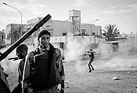 Anti-Gaddafi fighter launches RGP towards Gaddafi loyalist position in Sirte, Libya.