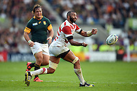Michael Leitch of Japan passes the ball. Rugby World Cup Pool B match between South Africa and Japan on September 19, 2015 at the Brighton Community Stadium in Brighton, England. Photo by: Patrick Khachfe / Stewart Communications
