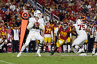 LOS ANGELES, CA - SEPTEMBER 11: Tanner McKee #18 of the Stanford Cardinal looks to pass the ball during a game between University of Southern California and Stanford Football at Los Angeles Memorial Coliseum on September 11, 2021 in Los Angeles, California.
