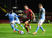Lincoln City's Tom Hopper vies for possession with Manchester City U21's Claudio Gomes, left, and Sammy Robinson<br /> <br /> Photographer Chris Vaughan/CameraSport<br /> <br /> EFL Papa John's Trophy - Northern Section - Group E - Lincoln City v Manchester City U21 - Tuesday 17th November 2020 - LNER Stadium - Lincoln<br />  <br /> World Copyright © 2020 CameraSport. All rights reserved. 43 Linden Ave. Countesthorpe. Leicester. England. LE8 5PG - Tel: +44 (0) 116 277 4147 - admin@camerasport.com - www.camerasport.com
