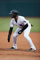 Yoelqui Cespedes (15) of the Winston-Salem Dash takes his lead off of first base against the Greensboro Grasshoppers at Truist Stadium on August 11, 2021 in Winston-Salem, North Carolina. (Brian Westerholt/Four Seam Images)