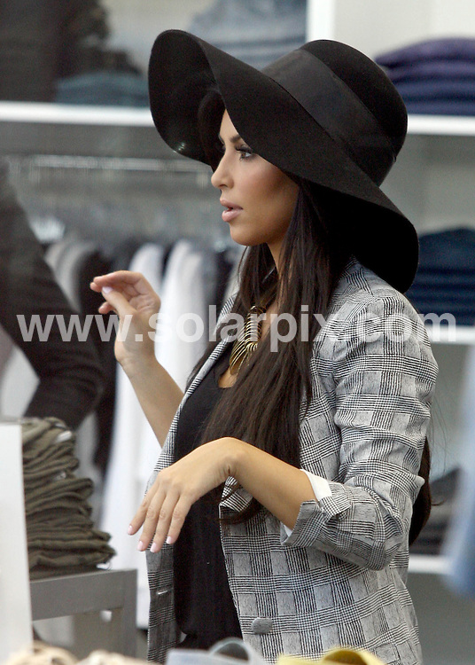 **ALL ROUND PICTURES FROM SOLARPIX.COM**.**SYNDICATION RIGHTS FOR UK AND SPAIN ONLY**..Kim and Khloe Kardashian shopping at 'Dalia's' in the valley, Los Angeles, filing thier Reality Show. Rumors are that Khole is pregnant, Khloe says that she is just fat. Khloe looks very 'Fat' in these pictures, I guess we will have to see if she is pregnant when the show airs..This pic:   Kim and Khloe Kardashian.JOB REF:   11398    STL       DATE:   04.06.10.**MUST CREDIT SOLARPIX.COM OR DOUBLE FEE WILL BE CHARGED**.**MUST NOTIFY SOLARPIX OF ONLINE USAGE**.**CALL US ON: +34 952 811 768 or LOW RATE FROM UK 0844 617 7637**