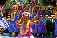 Young hula dancers wearing plumeria leis, Lei Day celebration at Hilton Hawaiian Village Hotel