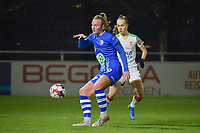 Gent's Lobke Loonen (L) and OHL's  Marith Debondt (R) pictured during a female soccer game between  AA Gent Ladies and Oud Heverlee Leuven on the 9th matchday of the 2020 - 2021 season of Belgian Scooore Womens Super League , friday 11 th of December 2020  in Oostakker , Belgium . PHOTO SPORTPIX.BE | SPP | DIRK VUYLSTEKE