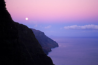 Beautiful moonrise along the Na Pali Coast; sunset over Kalalau Valley. Na Pali Coast State Park.