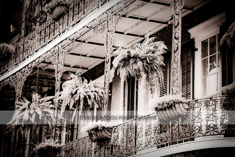 The Spanish-style architecture of the French Quarter of New Orleans, Louisiana dates back hundreds of years to the 1700s.  It is distinctive for the intricate, wrought iron balconies, central courtyards, and quaint doors and windows.