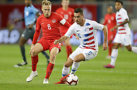 TORONTO, ON - OCTOBER 15: Daniel Lovitz #5 of the United States attempts to moves past Scott Arfield #8 of Canada during a game between Canada and USMNT at BMO Field on October 15, 2019 in Toronto, Canada.