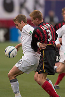 New England Revolution's Taylor Twellman tries to keep the MetroStars' Chris Leitch away from the ball. The New England Revolution played the NY/NJ MetroStars to a 1 to 1 tie at Giant's Stadium, East Rutherford, NJ, on April 25, 2004.