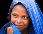In Ouagadougou, Burkina Faso, a Touareg woman shyly turns her face from the camera.   The Touareg are a nomadic ethnic group that are traditionally pastoralists.