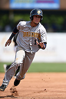 Burlington Bees shortstop Erick Salcedo (14) running the bases during a game against the Kane County Cougars on August 20, 2014 at Third Bank Ballpark in Geneva, Illinois.  Kane County defeated Burlington 7-3.  (Mike Janes/Four Seam Images)