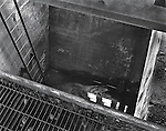 Looking down into the coal hopper of a coal burning power plant