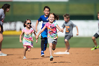 Young fans get the chance to run the bases following the South Atlantic League game between the Lakewood BlueClaws and the Kannapolis Intimidators at Kannapolis Intimidators Stadium on May 8, 2016 in Kannapolis, North Carolina.  The Intimidators defeated the BlueClaws 3-2.  (Brian Westerholt/Four Seam Images)