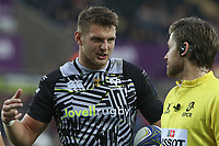 Dan Biggar of Ospreys discusses with the assistant referee whilst Referee Andrew Brace watches the TMO during the Champions Cup Round 1 match between Ospreys and Clermont at The Liberty Stadium, Swansea, Wales, UK. Sunday 15 October 2017