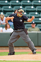 Home plate umpire Lawrence Reeves calls a batter out on strikes during the Carolina League game between the Myrtle Beach Pelicans and the Winston-Salem Dash at BB&T Ballpark on July 5, 2012 in Winston-Salem, North Carolina.  The Dash defeated the Pelicans 12-5.  (Brian Westerholt/Four Seam Images)