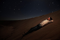 Brahim Mohamed Fadin, 17. Pictured in sand dunes near Smara refugee camp, Algeria: 'I don't like to be in the refugee camps. I know that the Algerians receive us and help us for many years but I want to be free in my own country. I am in High School in Algeria and Saharawis always get the best grades there. We are learning for our people, we learn to spread our history and in Algeria we can do that. I'm studying maths and my goal is to be an engineer. I wish I could help my country, it needs a lot of specialists. I would rather live in the camps than live under Moroccan control.'..
