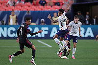 6th June 2021. Denver, Colorado, USA;  United States midfielder Weston McKennie (8) mistimes a header during the CONCACAF Nations League finals between Mexico and the United States  at Empower Field at Mile High in Denver, CO.