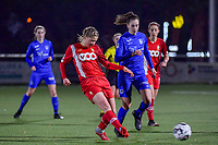 Aster Janssens (5) of Standard and Gwen Duijsters (13) of KRC Genk pictured during a female soccer game between  Racing Genk Ladies and Standard Femina on the 13 th matchday of the 2020 - 2021 season of Belgian Scooore Womens Super League , friday 5 th of february 2021  in Genk , Belgium . PHOTO SPORTPIX.BE | SPP | STIJN AUDOOREN