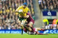 Nathan Sharpe of Australia is tackled during the Cook Cup between England and Australia, part of the QBE International series, at Twickenham on Saturday 17th November 2012 (Photo by Rob Munro)