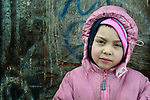 Five year-old Rada Stankovic stands beside her family's home in an illegal Roma settlement in Belgrade, Serbia. In February 2012, the family received notice from city officials that they it will be evicted in March 2012 to make way for new high-rise office buildings.  In April 2012, the Serbian Orthodox family was forcibly evicted from the city center and given a metal shipping container in Makis, at the edge of Belgrade, where they could live. After several weeks, they were evicted from the shipping container because of her father's repeated fights with his neighbors, and at the end of 2012 lived in an informal Roma squatter settlement in nearby Palilula. In 2009, they had been evicted from another settlement in Belgrade..