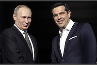Pictured L-R: Vladimir Putin and Alexis Tsipras greet each other on the steps of Maximos Mansion Friday 27 May 2016<br />