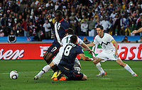 Jozy Altidore (17) of USA is brought down in the box by Bojan Jokic (center) of Slovenia, no penalty was given by referee Koman Coulibaly, ony a yellow card. USA tied Slovenia 2-2 in the 2010 FIFA World Cup at Ellis Park in Johannesburg, South Africa on June 18th, 2010.