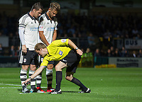 The Referee sprays the foam in from of Ross McCormack (left) of Fulham  and Alex Kacaniklic of Fulham during the Capital One Cup match between Wycombe Wanderers and Fulham at Adams Park, High Wycombe, England on 11 August 2015. Photo by Andy Rowland.