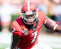 ATHENS, GA - OCTOBER 12: D'Andre Swift #7 of the Georgia Bulldogs runs with the ball during a game between University of South Carolina Gamecocks and University of Georgia Bulldogs at Sanford Stadium on October 12, 2019 in Athens, Georgia.