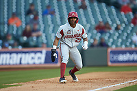 Christian Franklin (25) of the Arkansas Razorbacks takes his lead off of third base against the Oklahoma Sooners in game two of the 2020 Shriners Hospitals for Children College Classic at Minute Maid Park on February 28, 2020 in Houston, Texas. The Sooners defeated the Razorbacks 6-3. (Brian Westerholt/Four Seam Images)