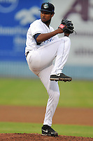 Asheville Tourists starting pitcher Jayson Aquino #32 delivers a pitch during a game against the Savannah Sand Gnats at McCormick Field on July 31, 2013 in Asheville, North Carolina. The Sand Gnats won the game 5-1. (Tony Farlow/Four Seam Images)