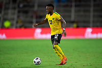 ORLANDO, FL - JULY 20: Junior Flemmings #12 of Jamaica dribbles the ball during a game between Costa Rica and Jamaica at Exploria Stadium on July 20, 2021 in Orlando, Florida.