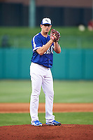 Oklahoma City Dodgers pitcher Eric Surkamp (41) gets ready to deliver a pitch during a game against the Fresno Grizzles on June 1, 2015 at Chickasaw Bricktown Ballpark in Oklahoma City, Oklahoma.  Fresno defeated Oklahoma City 14-1.  (Mike Janes/Four Seam Images)