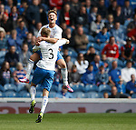 Iain Russell scores the second goal for QoS and celebrates with Kevin Holt