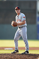 Connecticut Tigers pitcher Austin Pritcher (12) gets ready to deliver a warmup pitch during a game against the Batavia Muckdogs on July 21, 2014 at Dwyer Stadium in Batavia, New York.  Connecticut defeated Batavia 12-3.  (Mike Janes/Four Seam Images)