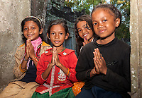 Cambodia.  Preah Khan.  Young Girls Making the Gesture of Welcome.