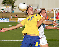 USA's Christie Rampone, right, tangles with Sweden's Maria Aronsson (10) second half, Saturday, July 15, 2006 in Blaine, Minn.