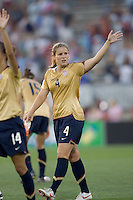 Cat Whitehill (United States, gold) waves to the fans. The United States defeated Norway, 1-0, in Rentschler Stadium, July 14, 2007.