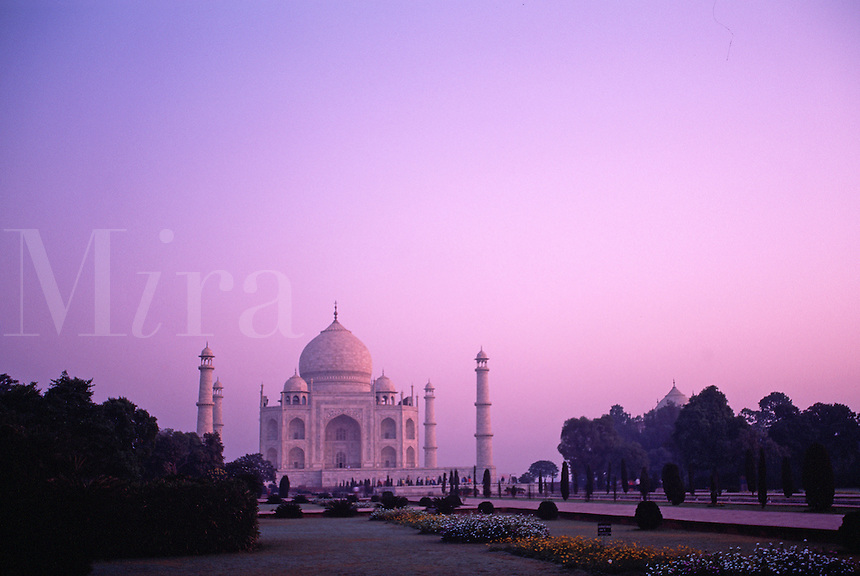 Exterior view of the distant Taj Mahal at sunrise. Agra, India.