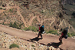 Backpackers hiking down the South Kaibab Trail to the Colorado River and Phantom Ranch Campground, Grand Canyon National Park, northern Arizona, USA .  John leads hiking and photo tours throughout Colorado. . John offers private photo tours in Grand Canyon National Park and throughout Arizona, Utah and Colorado. Year-round.