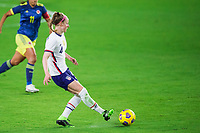 ORLANDO, FL - JANUARY 18: Becky Sauerbrunn #4 of the USWNT kicks the ball during a game between Colombia and USWNT at Exploria Stadium on January 18, 2021 in Orlando, Florida.