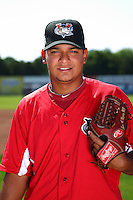 Tri-City ValleyCats pitcher Juri Perez #15 poses for a photo before a game against the Batavia Muckdogs at Dwyer Stadium on July 15, 2011 in Batavia, New York.  Batavia defeated Tri-City 4-3.  (Mike Janes/Four Seam Images)