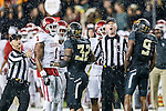 Players exchange words during the game between the Oklahoma Sooners and the Baylor Bears at the McLane Stadium in Waco, Texas. OU defeats Baylor 44 to 34.