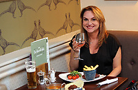 A woman enjoys a meal in the restaurant