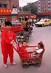 China Beijing 1980s. Chinese government One Child Policy was introduced to controle the size of the population. As a result many more boys were born. Girls were aborted before birth or died shortly after. 97.5% of all abortions were on a female foetus. Girls were considered to be a much greater expense on the family, especially in rural communities. Boys were spoilt and known as Little Emperors.