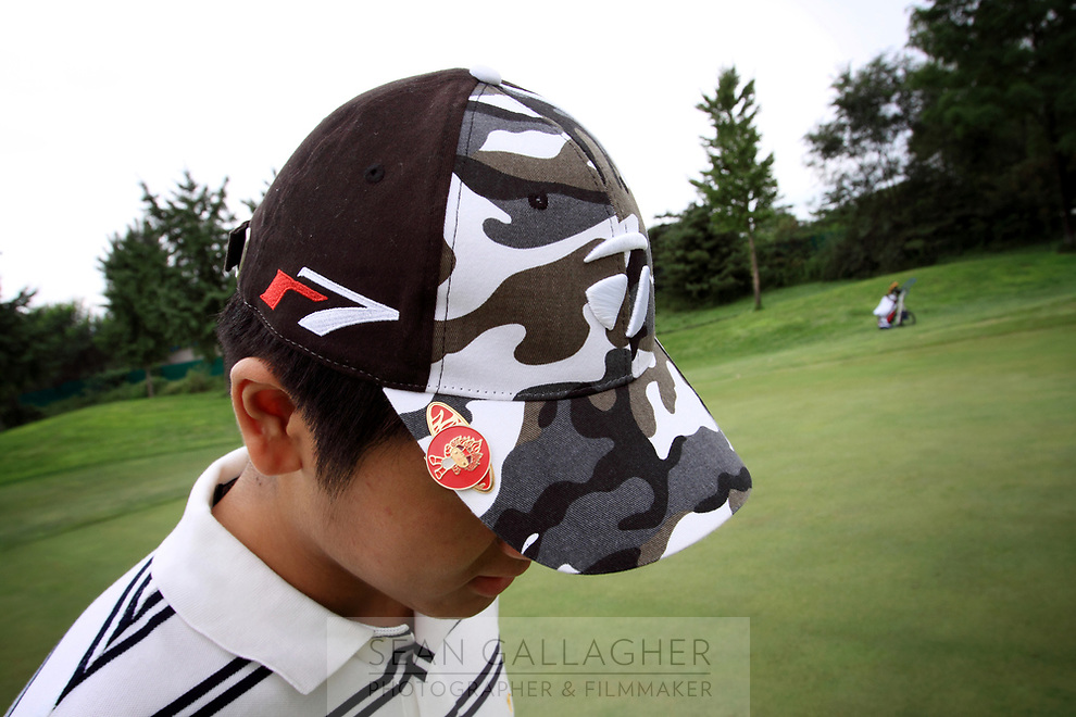 CHINA. Peter Fu (16), a young Chinese golfer at the Huatang International Golf Club in Beijing. 2009