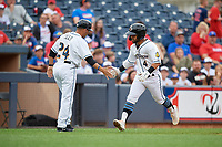 Akron RubberDucks manager Rouglas Odor (24) congratulates Ka'ai Tom (4) after hitting a home run during an Eastern League game against the Reading Fightin Phils on June 4, 2019 at Canal Park in Akron, Ohio.  Akron defeated Reading 8-5.  (Mike Janes/Four Seam Images)