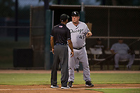 AZL White Sox manager Tommy Thompson (49) talks to field umpire Quentin Motte during an Arizona League game against the AZL Dodgers at Camelback Ranch on July 7, 2018 in Glendale, Arizona. The AZL Dodgers defeated the AZL White Sox by a score of 10-5. (Zachary Lucy/Four Seam Images)